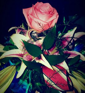Photo of Farrel's wedding bouquet with her dad's favorite tie intertwined among the roses and lilies. Used to illustrate the blog,
