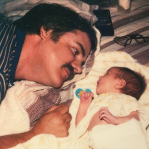 Photo of Dad and daughter Farrel when she was only a few weeks old. Used to illustrate the blog,
