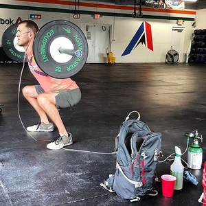 """Photo of Zack DeBaltzo doing CrossFit while wearing oxygen. Used to illustrate the blog post, """"Cross Strength""""."""